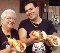 The top-ranked cheesesteaks of John´s Roast Pork are displayed by  Anthony Bucci and his mother, Vonda.