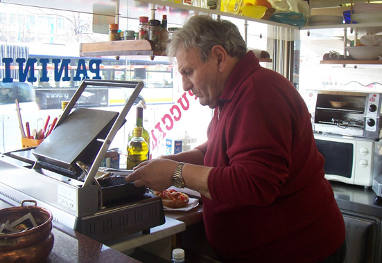 "A Turin, Italy, shop owner, who introduced himself as ""Lele,"" prepares an advertised ""Philly Cheese Steak."""