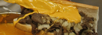 Cheez Whiz being slathered on at Pat&acute;s King of Steaks.