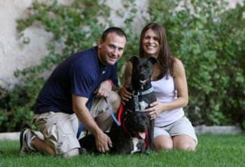 Vick dog Cherry posing with his new family