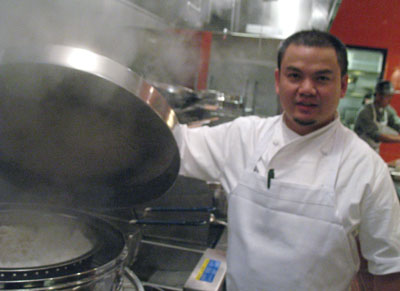 Chef Tyson Wong Ophaso with his old steamer.