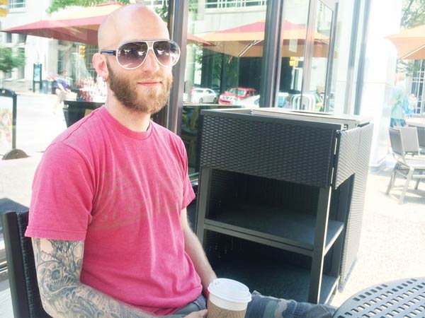 Josh Goldbloom enjoys a cup of coffee at the Panera Bread at 12th and Arch streets. He didn't cause any harm to the zombie-fighting sheriff.