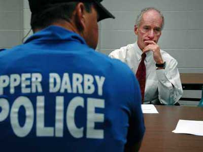 9/20/05, photo by Laurence Kesterson, Drexel Hill, Pa. IN THIS PHOTO: The new Upper Darby Police Superintendent Michael Chitwood (right) meets with police officers and school officials at Upper Darby High School Tuesday morning. THE STORY: Profile on new Upper Darby top cop Michael Chitwood. reporter/arnold 1 of 2 <br />