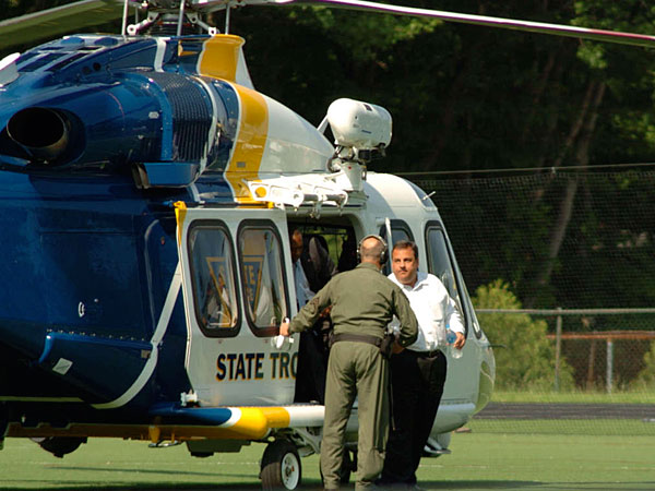 Gov. Christie arriving via state helicopter at Montvale, where he later watched his son´s baseball game in 2011. He has said he uses the aircraft to balance his duties of work and home.