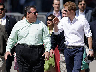 Britain´s Prince Harry, right, walks with New Jersey Gov. Chris Christie at Casino Pier during a tour of the area hit by Superstorm Sandy, Tuesday, May 14, 2013, in Seaside Heights, N.J. The prince toured the community´s rebuilt boardwalk, which is about two-thirds complete. New Jersey sustained about $37 billion worth of damage from the storm. (AP Photo/Julio Cortez)