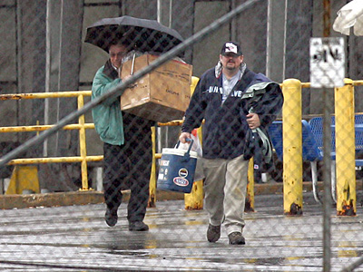 File photo: Two people leave the Chrysler plant in Newark, Delaware in 2008. A thousand employees lost their jobs when the cash-starved company closed the complex.