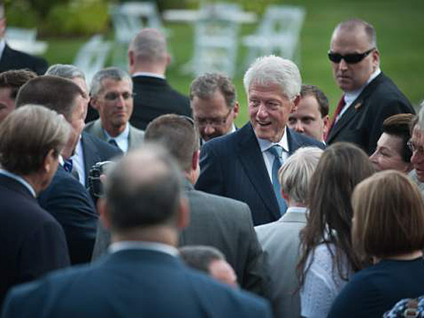 Former president Bill Clinton greets Trib Total Media employees after speaking at Penguin Court in Ligonier in honor of Trib Total Media publisher Richard Mellon Scaife on Saturday, August 2, 2014.