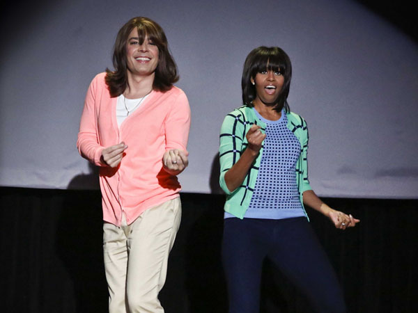 "This image released by NBC shows host Jimmy Fallon dressed as a mom, left, dancing with first lady Michelle Obama during an appearance of ""Late Night with Jimmy Fallon.""    (AP Photo/NBC, Lloyd Bishop)"
