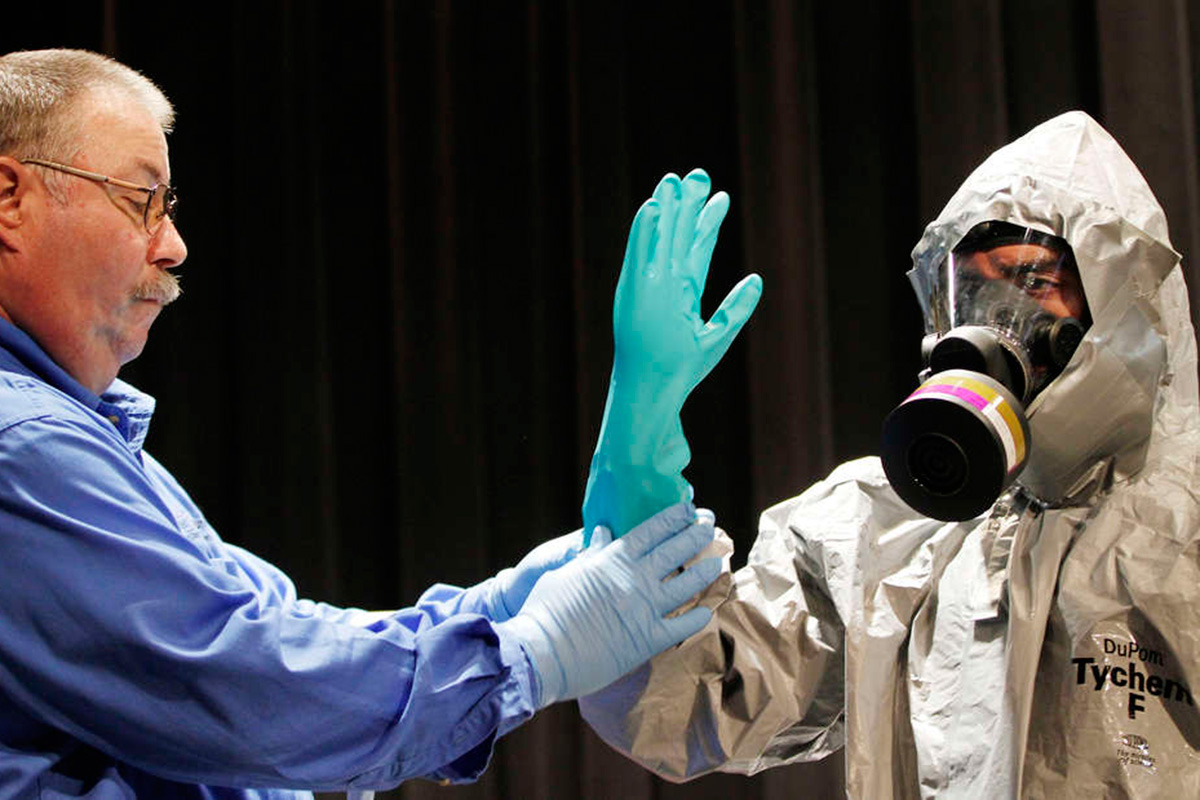 Ernest Smith (left) and Christopher Costa train Camden County first responders to deal with the threat of Ebola in October 2014.