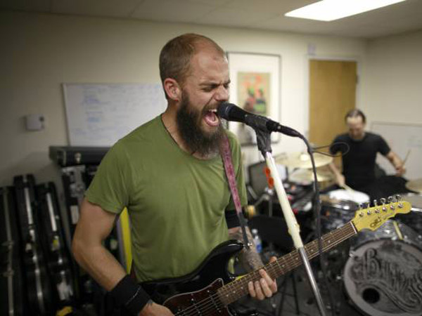 John Baizley, leader of the acclaimed Philadelphia metal band Baroness, and his band mates practise. Last year, the band was in a serious bus crash in Bath, England, which landed them in the hospital just as they were releasing their breakthrough album, Yellow & GreenMay 21, 2013. ( DAVID SWANSON / Staff Photographer )
