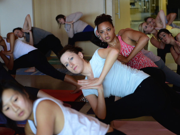 Julep employees perform Utkatasana, or Chair Pose, during their free weekly session, paid for by their employer, in the Julep offices on Queen Anne, August 22, 2013. (Lindsey Wasson/Seattle Times/MCT)