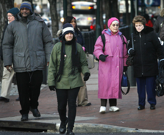Pedestrians bundled up because of the cold at Sixth and Market Streets in Philadelphia on Jan. 4, 2010.<br />