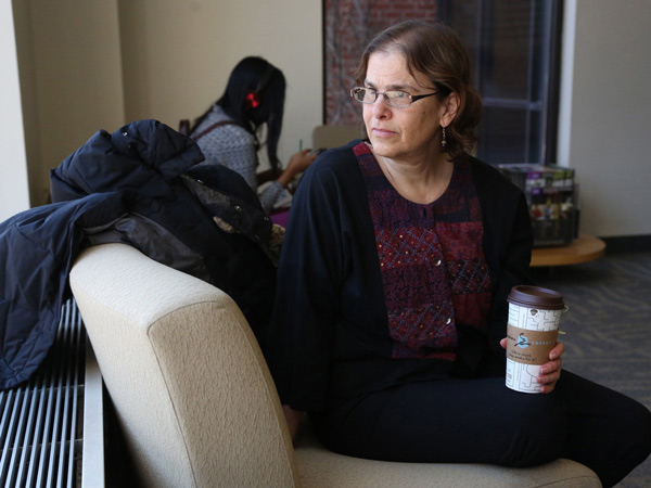 Without and office, professor Anne Winkler-Morey looks out the window as she waits in the lobby to meet a student before class on March 5, 2014. Winkler-Morey teaches as an adjunct professor at Metro State University in Minneapolis. (Kyndell Harkness/Minneapolis Star Tribune/MCT)