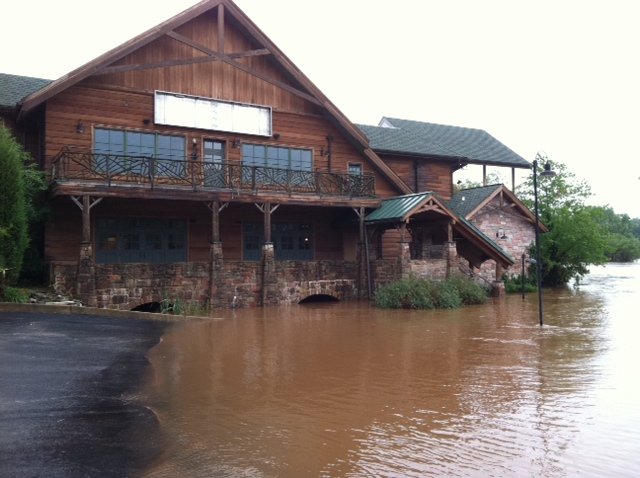 The Perkiomen Creek's waters threaten to overtake the Collegeville Inn on Wednesday.