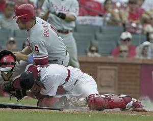 Eric Bruntlett slams into Yadier Molina's back in the ninth inning yesterday. Bruntlett was out. So was Molina.