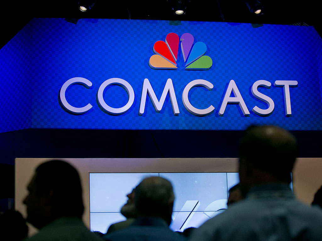 The Comcast Corp. logo is seen on the exhibit floor at the National<br />Cable and Telecommunications Association (NCTA) Cable Show in<br />Washington, D.C., U.S., on Tuesday, June 11, 2013. (Andrew Harrer/Bloomberg)