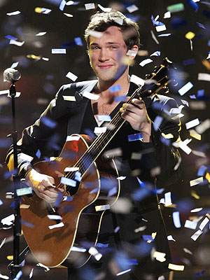 Idol winner Phillips takes the confetti shower