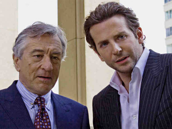 Bradley Cooper (right) as the blocked writer stimulated by a wonder drug, with Robert De Niro in the smart thriller ´Limitless.´