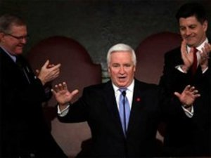 Gov. Corbett, joined by Speaker of the House Sam Smith (left) and Lt. Gov. Jim Cawley, delivering his budget address on Tuesday. He said he was not ready to expand Medicaid. (Matt Rourke / Associated Press)