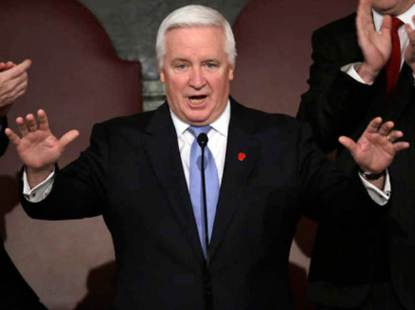 FILE: Gov. Corbett draws applause at a joint session of the Pennsylvania House and Senate. MATT ROURKE / Associated Press