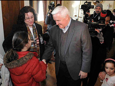 Gov. Corbett greets guests outside the family dining room at the governor´s residence.  (JASON MINICK / Associated Press)