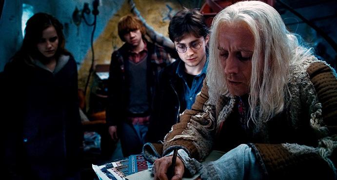 Emma Watson, Rupert Grint, Daniel Radcliffe, and Rhys Ifans as Xenophilius Lovegood.