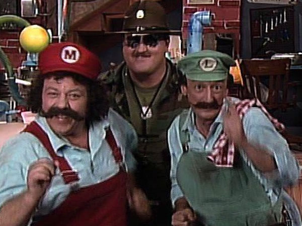 Danny Wells and Lou Albano as Luigi and Mario pose with the WWF´s Sgt. Slaughter (Robert Remus). Wells passed away Nov. 28 at the age of 72.
