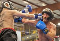 Danny Bonaduce, right,  takes a shot to the face from Wired 96.5´s Justice in the second round of their charity boxing match in January. (Michael Bryant / Inquirer)