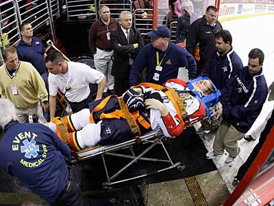 Florida Panthers forward David Booth is wheeled off the ice after being injured by Mike Richards in the second period against the Flyers on Oct. 24. (AP Photo / Matt Slocum)
