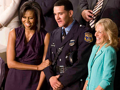 Richard DeCoatsworth in happier times, as he joined first lady Michelle Obama and Jill Biden at a presidential address in 2009. (Associated Press/File)