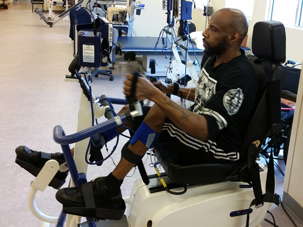 Delano Turnipseed works out on a seated elliptical machine designed specifically for individuals with leg paralysis. (Julie Coté, Magee Riverfront)