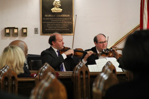 Philadelphia Orchestra violinists Paul Roby (left) and William Polk perform Mozart Monday at a memorial for conductor James DePreist.