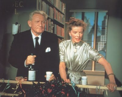 Spencer Tracy and Katharine Hepburn at the office Christmas party in Desk Set.