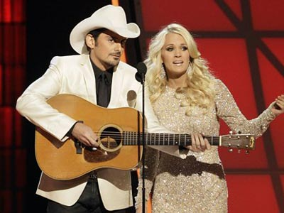 Hosts Brad Paisley, left, and Carrie Underwood perform an opening number onstage at the 46th Annual Country Music Awards at the Bridgestone Arena on Thursday, Nov. 1, 2012, in Nashville, Tenn. (Photo by Wayde Payne/Invision/AP)
