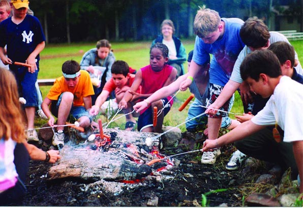 Around the campfire at Camp Setebaid, a summer getaway in the Poconos for kids with diabetes.