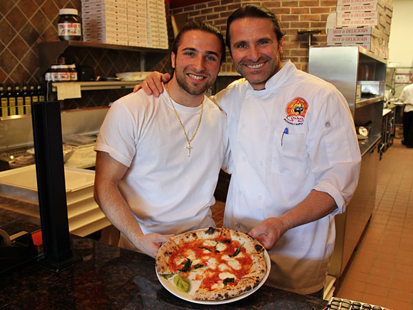 Pino DiMeo (right) and his son Antimo at Pizzeria DiMeo´s in Andorra Shopping Center.  MICHAEL KLEIN / Philly.com