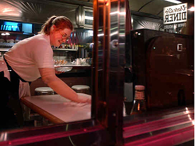In better times, Heather Hane prepared a booth for customers at the Vale-Rio. The diner´s closing put 44 people out of work. (Laurence Kesterson / Staff)