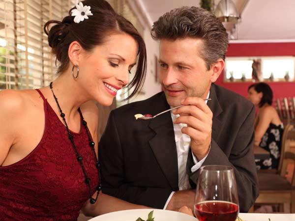 Couple sharing dessert at a restaurant.