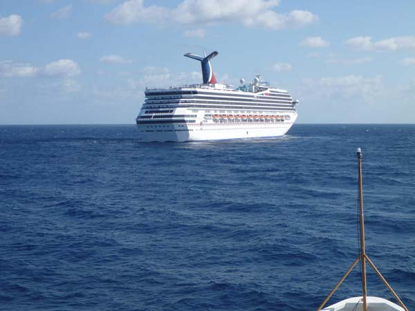 In this image released by the U.S. Coast Guard on Feb. 11, 2013, the Coast Guard Cutter Vigorous patrols near the cruise ship Carnival Triumph in the Gulf of Mexico, Feb. 11, 2013. The Carnival Triumph has been floating aimlessly about 150 miles off the Yucatan Peninsula since a fire erupted in the aft engine room early Sunday, knocking out the ship´s propulsion system. No one was injured and the fire was extinguished. (AP Photo/U.S. Coast Guard- Lt. Cmdr. Paul McConnell)