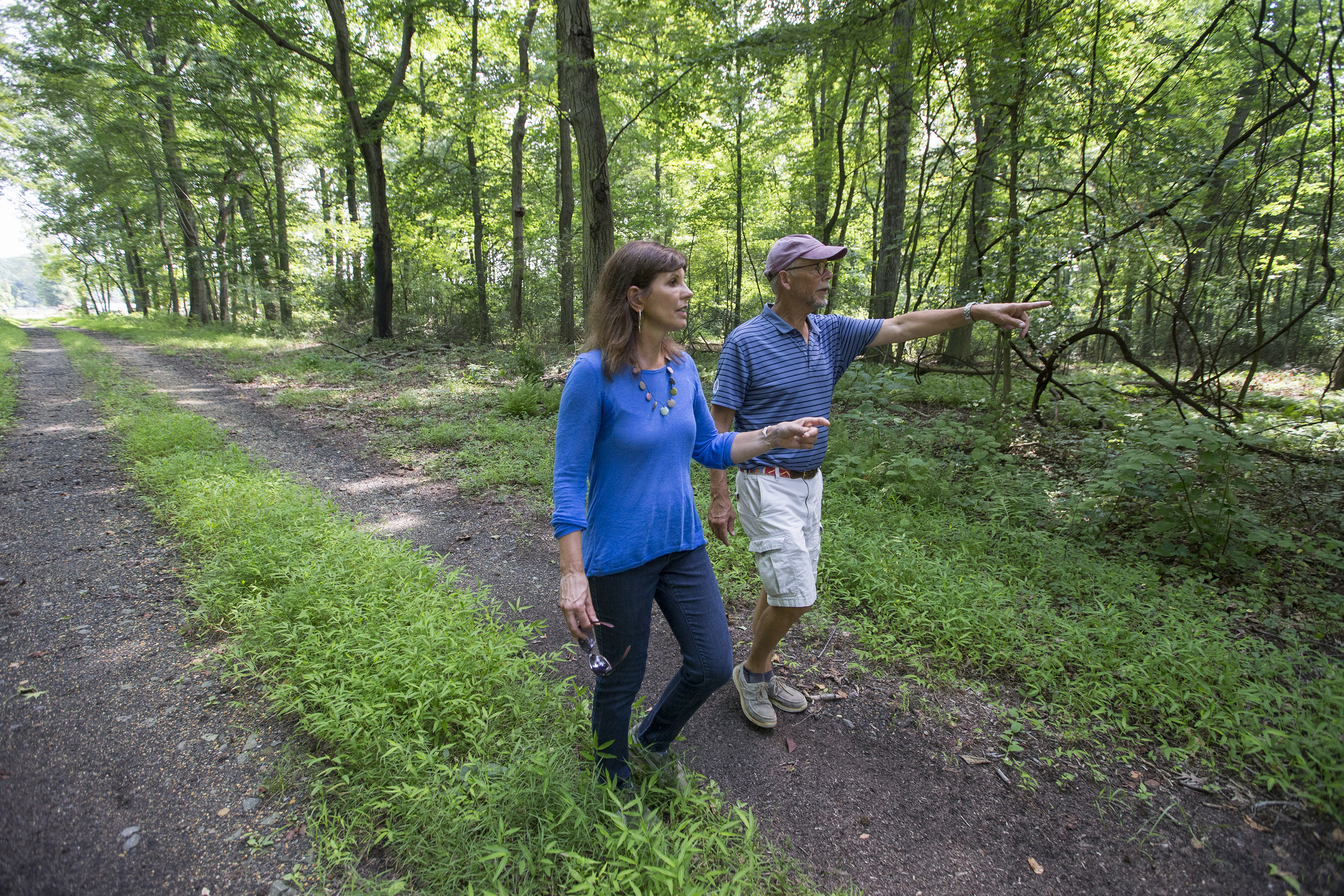 Chesterfield Township Councilwoman Rita Romeu, left, and environmentalist Glenn Ashton walk through a wooded area near the pipeline construction. In Chesterfield Township and Bordentown, a fight is brewing over a proposed natural gas pipeline that would connect the Burlington County township with Manchester Twp in Ocean County. Workers install the pipeline in Bordentown near the New Jersey Turnpike. CHARLES FOX / Staff Photographer