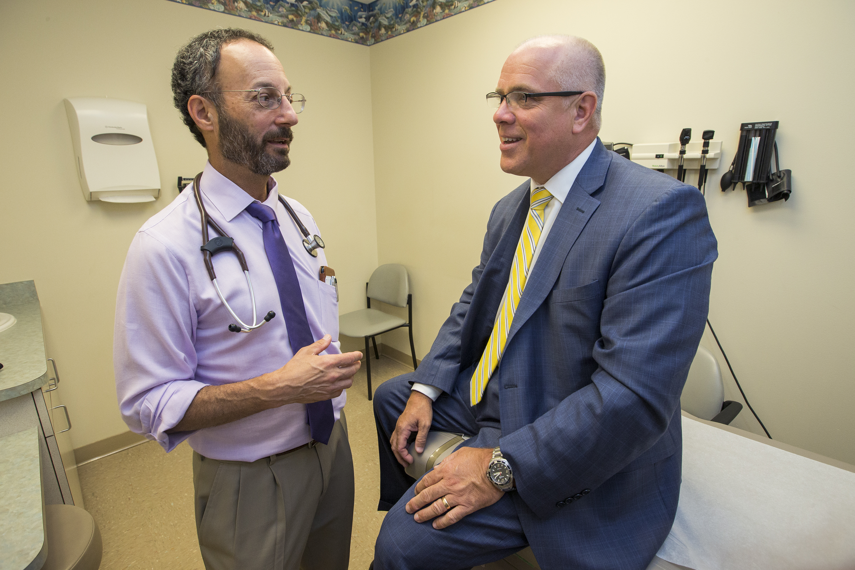 Neil Skolnik, left, a doctor in Jenkintown, talks with Tom Nadolski, right, a long-time patient who changed his behavior after Skolnik did.