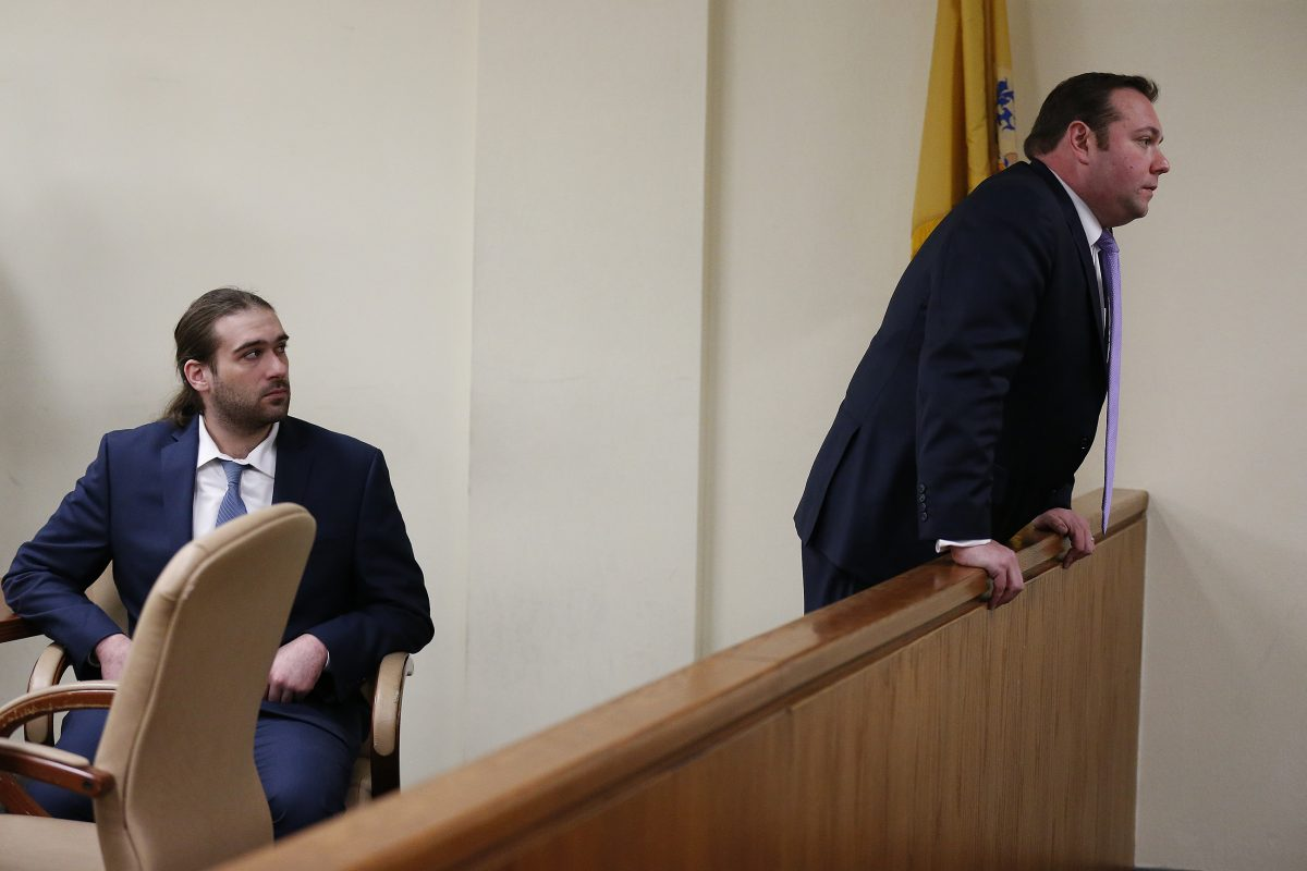 "David ""D.J."" Creato Jr. looks on as his defense attorney, Richard J. Fuschino Jr., talks to   members of the Creato family at the end of the day at Creato's trial in Camden, New Jersey, on Tuesday, May 23, 2017. Jury deliberation began later in the day."