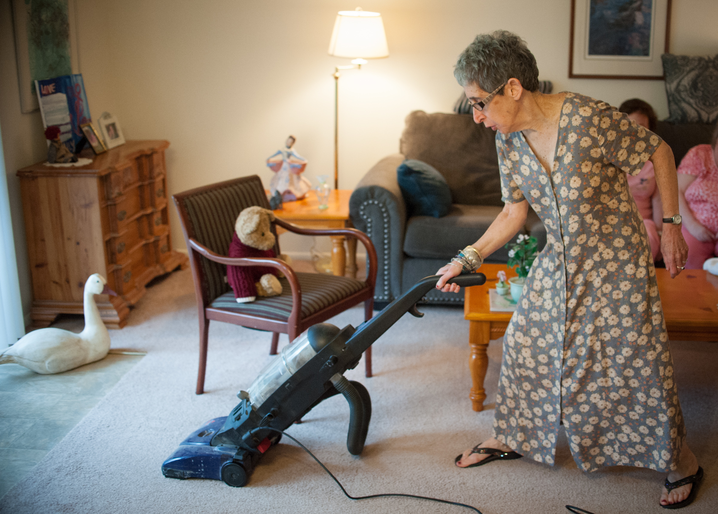 Harriet, 62, vacuums in her living room, August 7th, 2017. CAMERON B. POLLACK / Staff Photographer