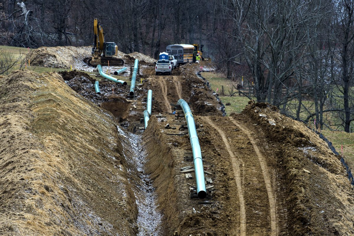 Workers install the Mariner East 2 pipeline earlier this year in a trench in western Pennsylvania.