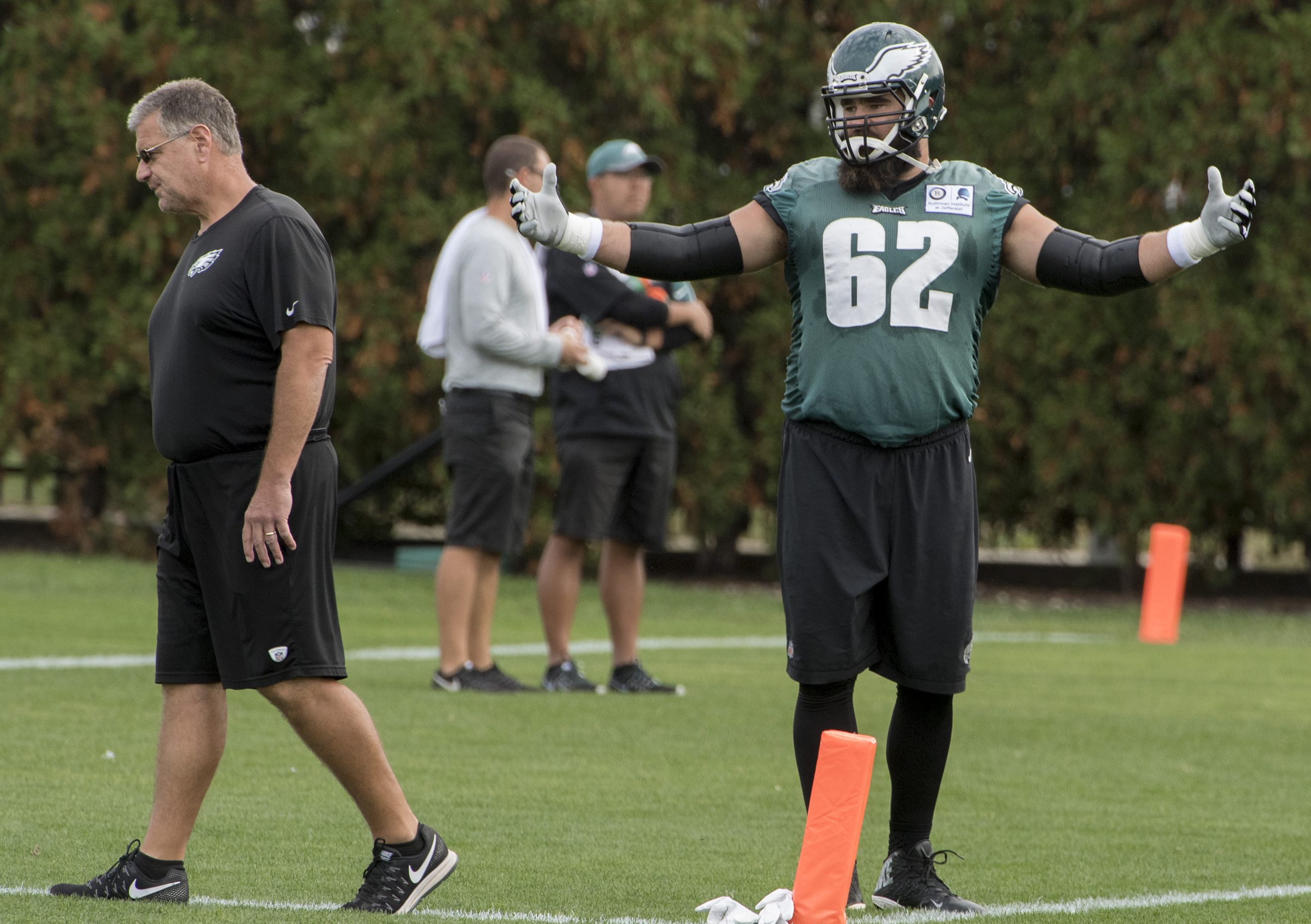 Eagles center Jason Kelce reacts as offensive-line coach Jeff Stoutland passes by during an October 2016 practice.