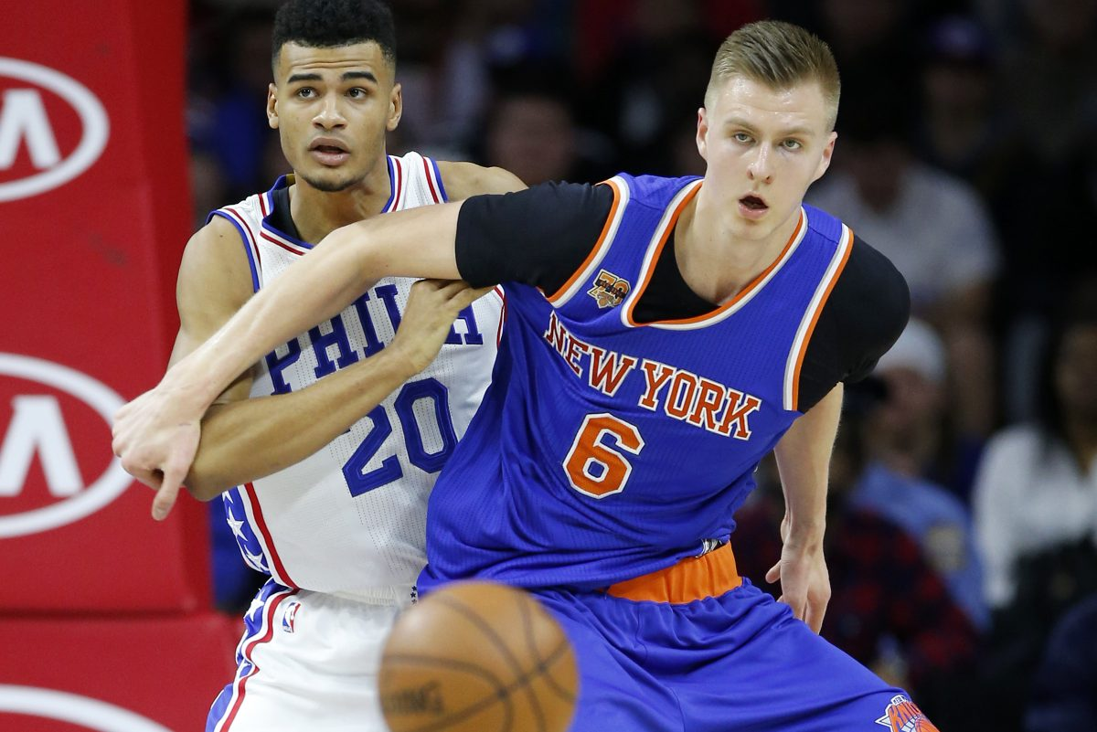 New York's Kristaps Porzingis is guarded by the Sixers' Timothe Luwawu-Cabarrot in a January game.