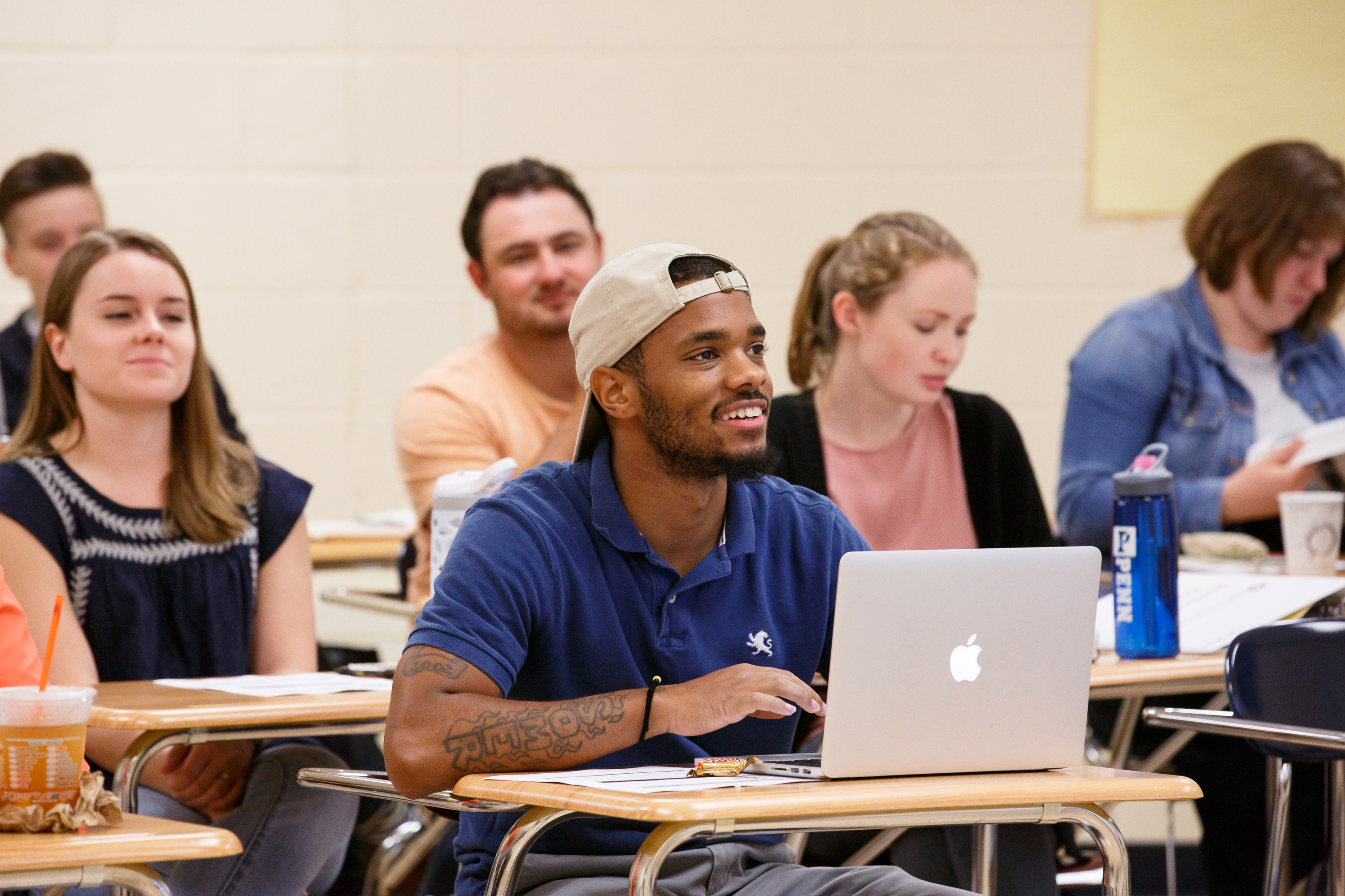 Quamiir Trice, center, shown here in new-teacher orientation at the Arts Academy at Benjamin Rush, Tuesday, Aug. 8, 2017. Trice will have a class full of fourth graders at Bethune Elementary in North Philadelphia in the fall. ( JESSICA GRIFFIN / Staff Photographer )