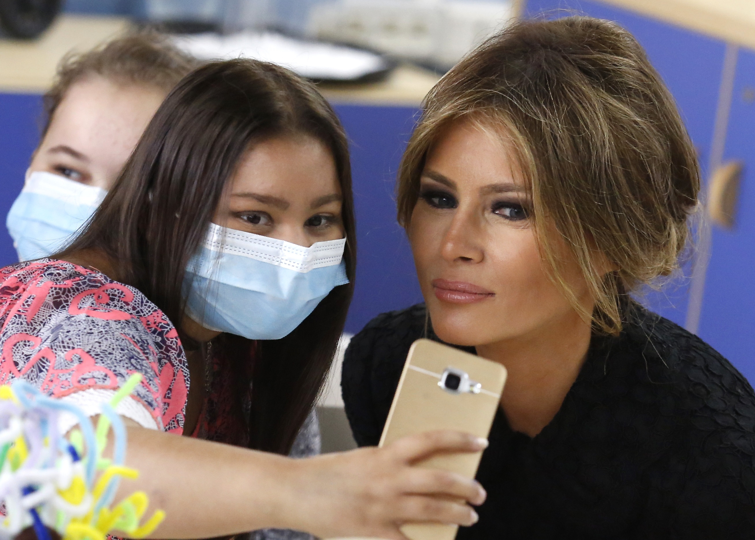 First Lady Melania Trump poses for a selfie with a girl during her visit to the pediatric hospital affiliated with The Vatican. (Remo Casilli/Pool Photo via AP)
