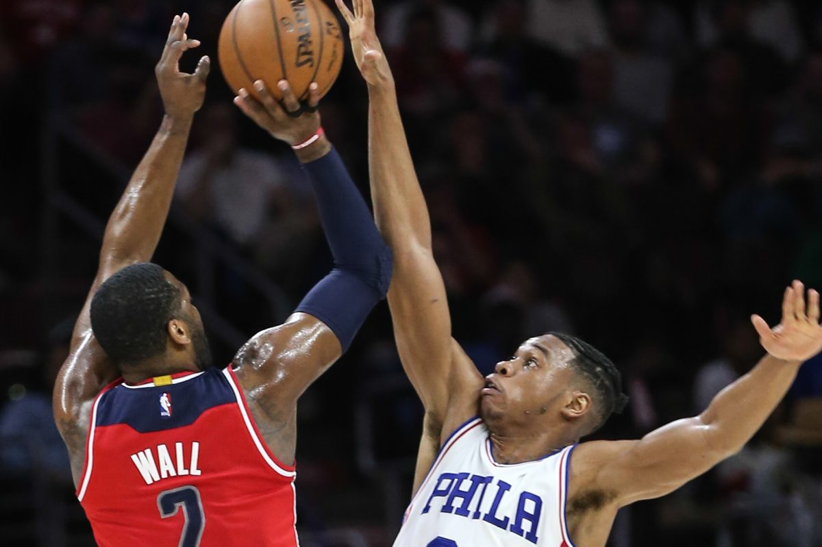 Richaun Holmes of the Sixers blocks the shot of Washington's John Wall during their game on Feb. 24 last season.