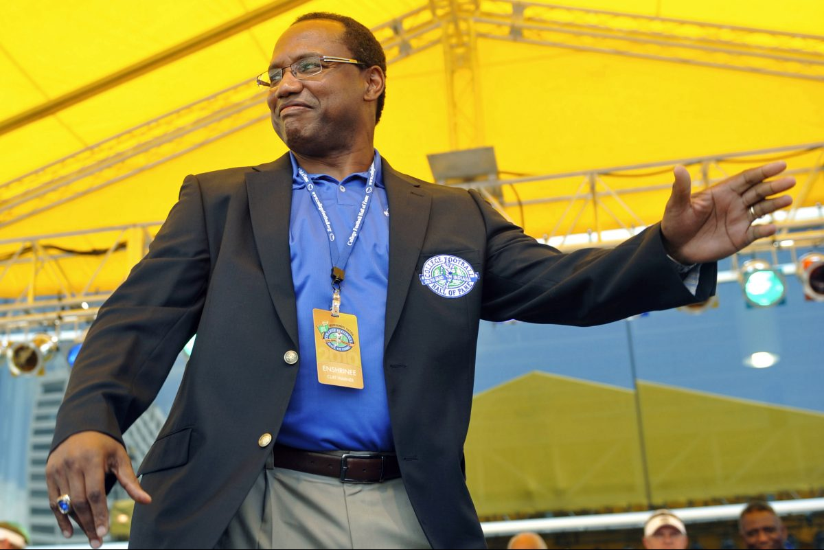 Curt Warner waves to the crowd after receiving his College Football Hall of Fame jacket during the enshrinement ceremony in July 2010 in South Bend, Ind.